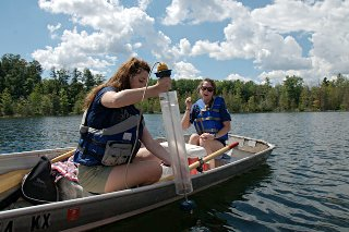 WSI interns Jessica Rhodes and Chelsea Cooper test water quality on a local lake