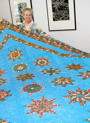 'Stack 'n Whack Stars' Quilt, queen; made by Bonnie King (pictured) and quilted by Marty Beer