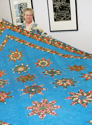 'Stack 'n Whack Stars Quilt, queen; made by Bonnie King (pictured) and quilted by Marty Beer