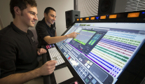 Students working on the state-of-the-art Raven MTX mixing console