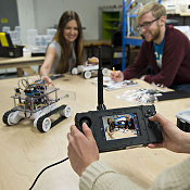 Students work with a robot in an NMC engineering technology course