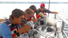 Freshwater Studies students and Constanza Hazelwood with microscopes