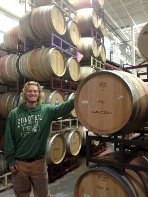Plant science student and wine barrels