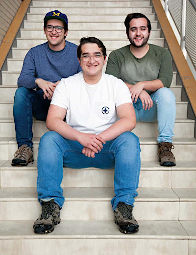 Massimo Vozza, front, and his brothers Dante, left, and Angelo, right, all dual-enrolled at NMC during high school at Traverse City Central.